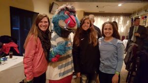 Red Stars players Arin Gilliland, Sofia Huerta and Danielle Colaprico with the Red Stars mascot Supernova.